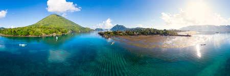 Aerial view Banda Islands Moluccas archipelago Indonesia, Pulau Gunung Api, Bandaneira village, coral reef caribbean sea. Kora Kora traditional canoe annuale race.