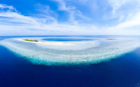 Aerial idyllic atoll, scenic travel destination Maldives Polinesia. turquoise coral reef. Shot in Wakatobi National Park, Indonesia