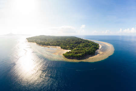 Aerial view tropical beach island reef caribbean sea. Indonesia Moluccas archipelago, Banda Islands, Pulau Ay. Top travel tourist destination, best diving snorkeling. 免版税图像