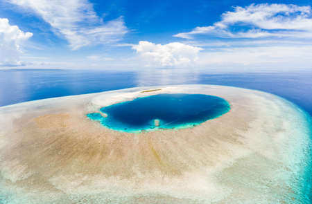 Aerial idyllic atoll, scenic travel destination Maldives Polinesia. Blue lagoon and turquoise coral reef. Shot in Wakatobi National Park, Indonesia Stock fotó
