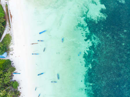 Aerial top down view boat tropical beach caribbean sea at Pasir Panjang. Indonesia Moluccas archipelago, Kei Islands, Banda Sea.