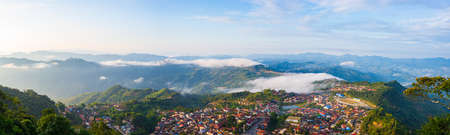 Aerial view of Phongsali, North Laos near China. Yunnan style town on scenic mountain ridge. Travel destination for tribal trekking in Akha villages. Fog and mist in the valley. Stock Photo