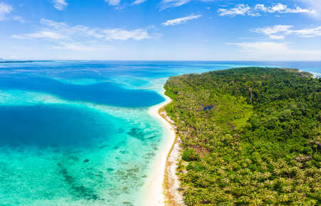 Aerial view tropical paradise pristine beach rainforest blue lagoon bay coral reef caribbean sea turquoise water at Banyak Islands Indonesia Sumatra remote travel adventure away from it all Stock Photo