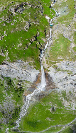 Aerial view of scenic high waterfall on the italian Alps. Tourism destination hiking outdoors activity. Pis waterfall near Torino, Piedmont, Italy Фото со стока