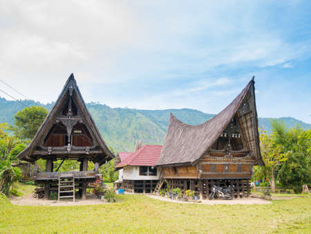 Lake Toba, Indonesia - circa February, 2019: Batak traditional houses in a row at Ambarita village, lake Toba, travel destination in Sumatra, Indonesia.