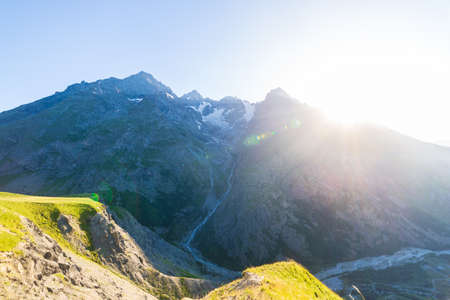 Mountain landscape of the french Alps, Massif des Ecrins. Scenic alpine landscape at high altitude with glacier, green meadows and hiking paths for tourism summer vacation