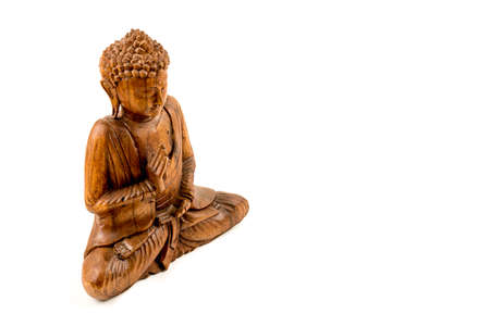 Wooden buddha statue on a white background Banco de Imagens