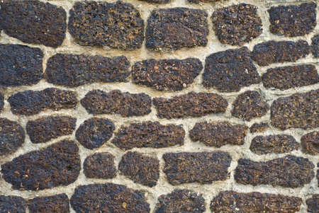 Old brick wall from an ancient church in England dated 1042