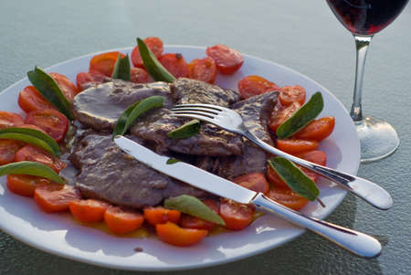 dinnertime: Scaloppine, italian meat cooked in red wine sauce, shot in natural light