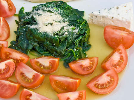 dinnertime: Spinach and Tomatoes shot in natural light, simple italian cuisine Stock Photo