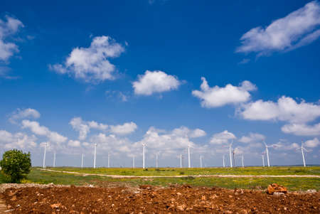 patchy: Wind turbines in a row under a patchy sky in Bulgaria