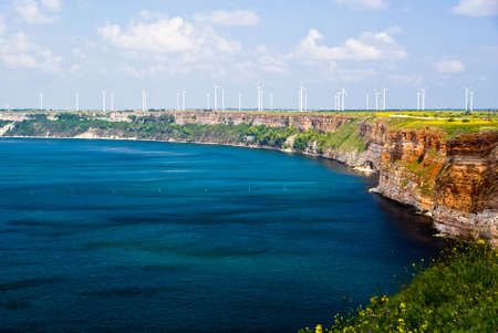 View of the Thracian cliffs with wind turbines on the background photo