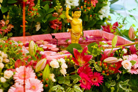 Statue of Buddha shot at the Bathing of Buddha cerimony. Focus on the statue. Stock Photo