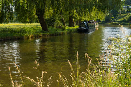House boat on the river Wey in Guildford, Surrey, during a sunny spring day.