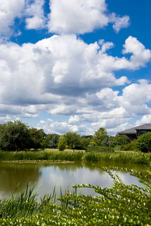 major: View of the Surrey Research Park lake. July 2008. A major centre of excellence in technology, science and engineering, The Surrey Research Park is widely regarded as the best of its kind in the UK.