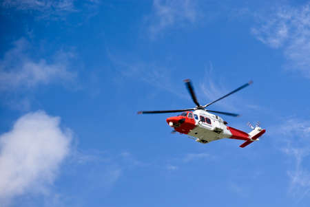 Coastguard helicopter in the blue sky