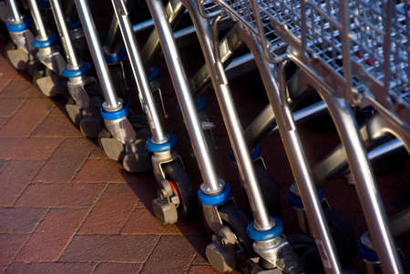 Closeup of empty shopping carts lined at the supermarket ready to be picked up Stock Photo - 3519435