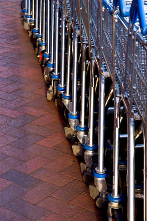 Empty shopping carts lined at the supermarket ready to be picked up