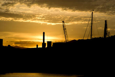 Silhouette of Imperia port at sunset Stock Photo