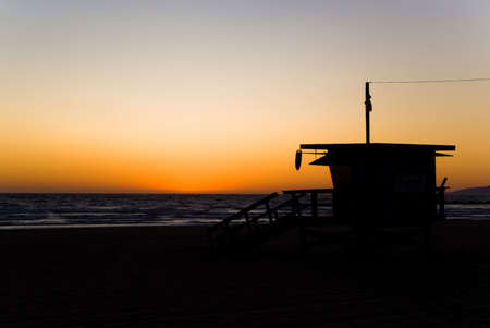 Lifeguard cabin in Venice Beach at sunset. photo