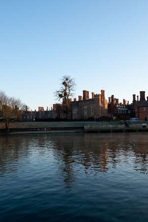 Hampton Court from the river Thames. Morning light. Stock Photo