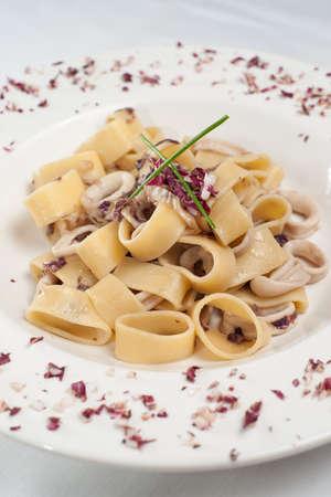 Pastai ai totani. Italian pasta with fish.