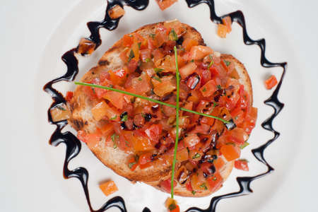 Italian bruschetta with tomato pieces. Downward view. Stock Photo