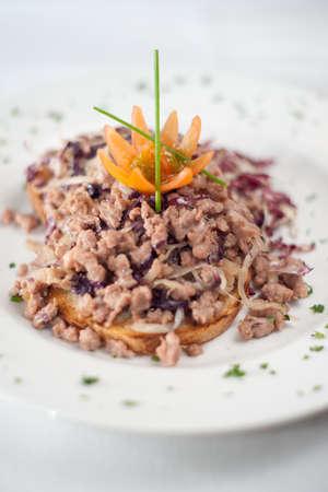 Bruschetta e salsiccia. Typical italian bruschetta with sausages. Shallow depth of field. Focus on the tomato. Stock Photo