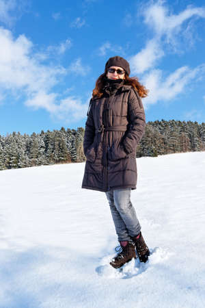 Beautiful Girl standing on snow. Copy space.
