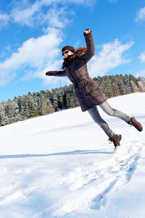 Girl jumping on snow. Portrait.