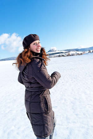 Girl running on snow. Copy space. photo