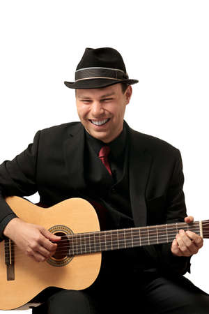 Attractive young man playing guitar  Headshot