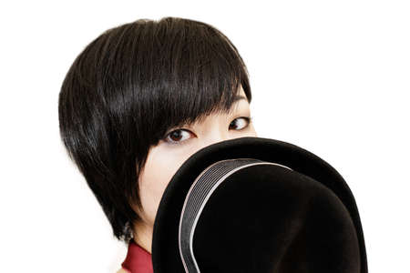 Beautiful asian woman covering her mouth with a hat  Isolated on white