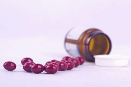 therapeutical: Drugs spreading on the table with medicine bottle  Stock Photo
