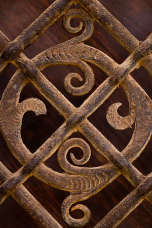 Wrought iron grid decoration on a wooden door photo