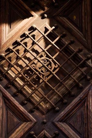 Wrought iron grid decoration on a dorr photo
