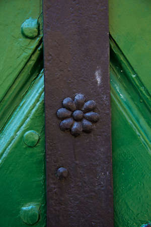 Wrought iron decoration of a wooden door photo