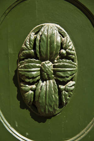 Close up of a wooden decoration on a door photo