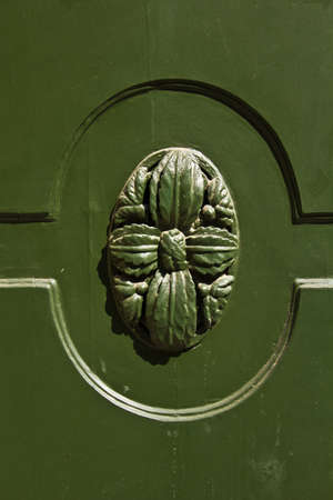 Wooden decoration of a green door photo