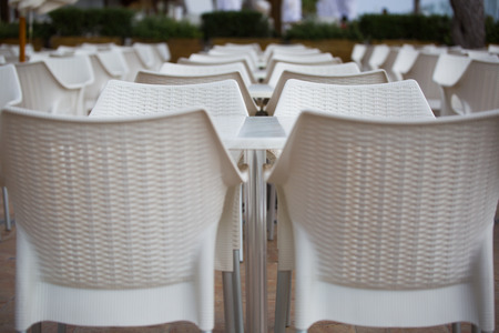 perfectly: Perfectly aligned chairs and tables on an open air terrace in a holiday resort