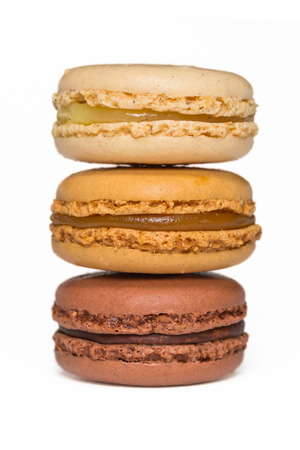 appetising: Vanilla, caramel and chocolate macaroons isolated on white Stock Photo