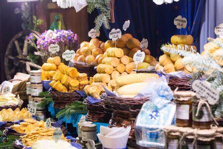 oscypek: Traditional Polish smoked cheese Oscypek on a Christmas market stall in Krakow, Poland.