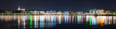 Panoramic view of lake Geneva and Geneva city skyline at night.