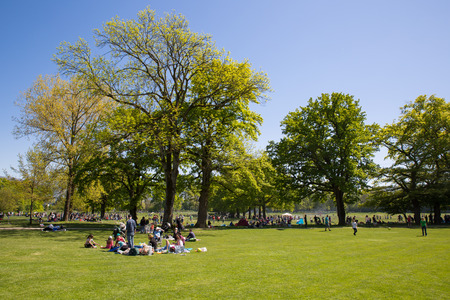 public holiday: Geneva, Switzerland - May 5, 2016: People filling public parks on the Ascension day, a public holiday.