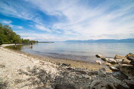 A beautiful rocky beach on lake Geneva near the city of Rolle, canton of Vaud, Switzerland.