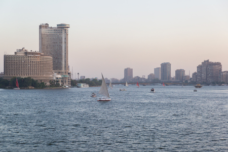 Cairo, Egypt - May 26, 2016: Felucca boats sailing on the Nile river in central Cairo at dusk. Editorial