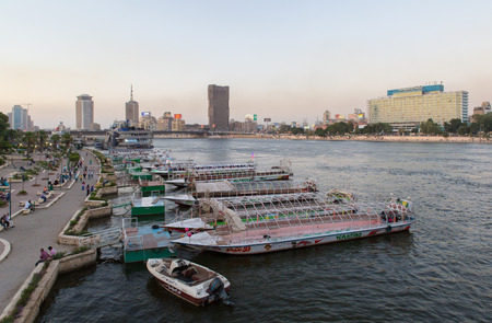 nile river: Cairo, Egypt - May 26, 2016: Party boats docked on the Nile river on the island of Zamalek in central Cairo.