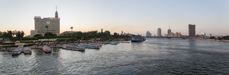 Cairo, Egypt - May 26, 2016: Panoramic view of party boats docked on the Nile river on the island of Zamalek in central Cairo.