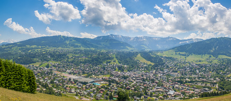 Panorama of the village of Megeve and surrounding mountains during summertime. Stock Photo