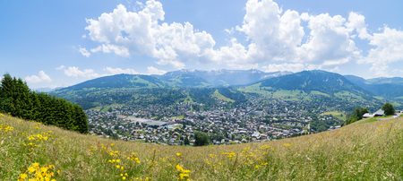 Panoramic view of the mountain village and ski resort of Megeve in the french alps, during summertime. Stock Photo